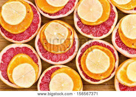 Stacked Red Grapefruit, Orange And Lemon Slices