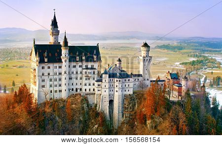 Neuschwanstein beautiful fairytale castle near Munich in Bavaria Germany with colorful trees.