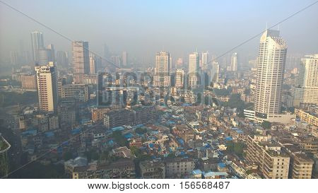 Guangzhou City, Guangdong in China in the misty morning