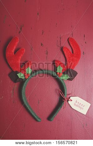 Christmas Reindeer Ears On Wood Background.