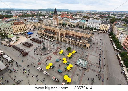 Top view of the Main Square of Krakow with monument to Adam Mickiewicz and the cloth hall (Rynek Glowny) Poland.