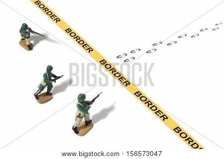 Still life of Toy Army Men Protecting a Border Crossing from Unknown Footprints