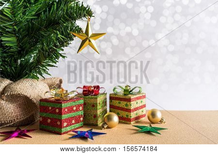Christmas background. Christmas tree golden balls and gift boxes.