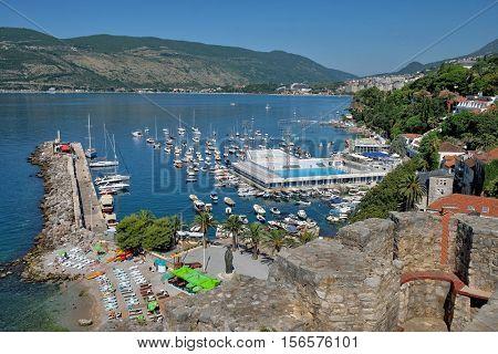 HERCEG NOVI, MONTENEGRO - JULY 18, 2016: aerial view of Kotor Bay and marina Herceg Novi with pleasure boat moored and sea pool