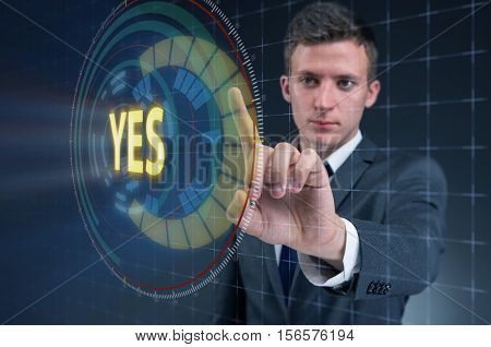 Businessman pressing virtual button YES