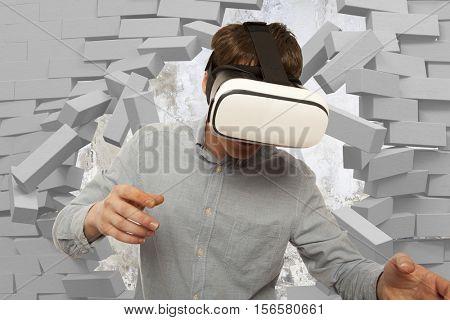 Young man wearing virtual reality glasses