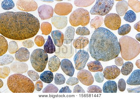 Pebble stone texture wall and seamless background.