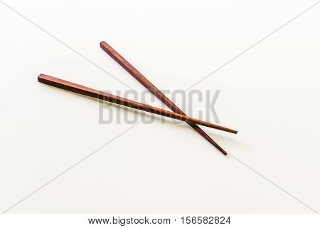 Wood chopstick isolated on the white background