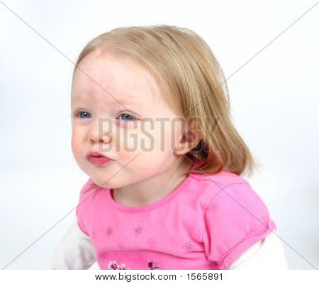 Cute Little Girl Blowing A Kiss On A White Background