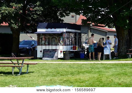 HARBOR SPRINGS, MICHIGAN / UNITED STATES - AUGUST 3, 2016: People may purchase hot dogs, hamburgers, and other food at Wally's Harbor Grill, adjacent to the Zorn Park Beach, near downtown Harbor Springs.
