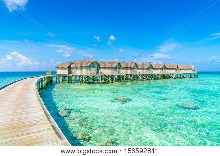 Beautiful water villas in tropical Maldives island