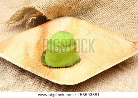 Kuih koo traditional Malay nyonya sweet desert on palm leaf jute