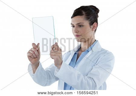 Beautiful female doctor holding digital tablet against white background