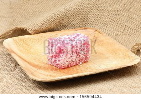 Kuih sagu traditional Malay nyonya sweet desert on palm leaf jute