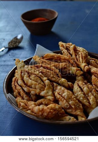 Champa kali-An Indian deep fried crisp snack made with flour and spices