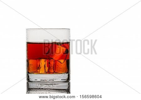 Glass With Ice Cubes And Whisky On White Background