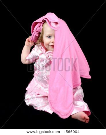 Cute Little Girl Peeking From Under Blanket