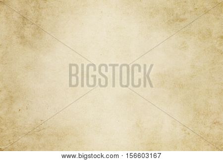 Aged dirty and yellowed paper background.Natural old paper for the design.