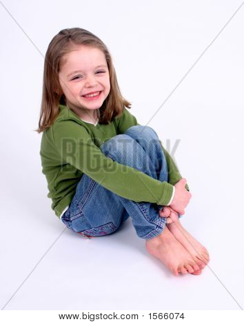 Cute Little Girl Smiling On A White Background