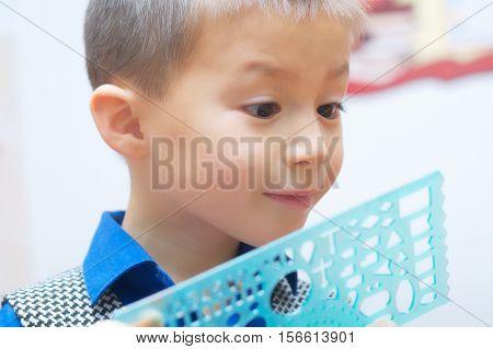 School Boy Amazed With School Stuff