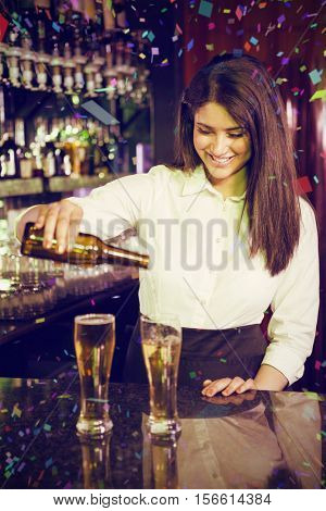 Female bartender pouring beer into glasses against flying colours