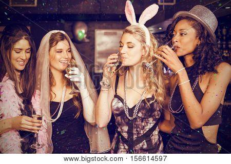 Friends celebrating bachelorette party against flying colours