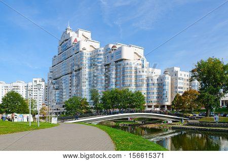 MINSK BELARUS - OCTOBER 1 2016: Humpback bridge over Svisloch and residential complex