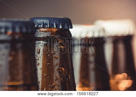 Close-up Of Fresh Cold Beer Ale Bottles With Drops And Focus On Stopper