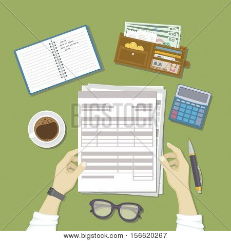 Man working with documents. Men's hands hold the accounts, payroll, tax form. Workplace with papers, notebook, wallet with money, calculator, pen, glasses, coffee. Work business, financial process.