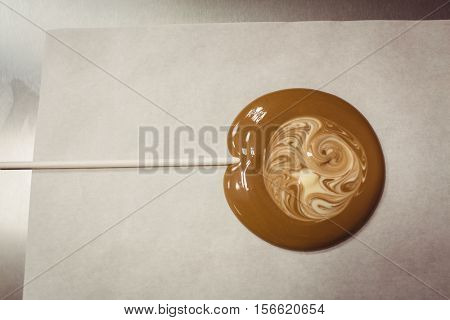 Close-up of lollipop drying on wax paper in kitchen