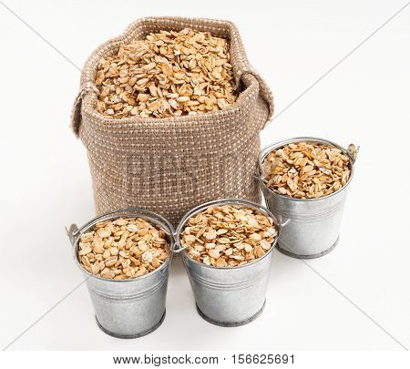 The bag and three bucket of oatmeal isolated on white background. Healthy food. High resolution product