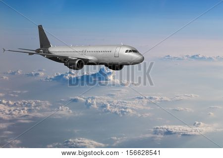 airplane in blue sky with white clouds