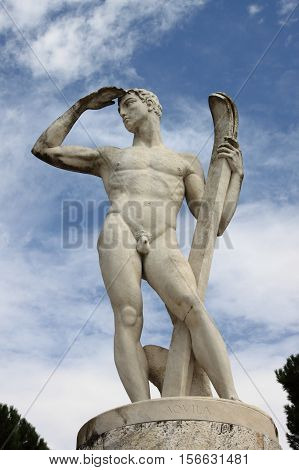 Statue of a skier in the Marble Stadium of Rome, Italy