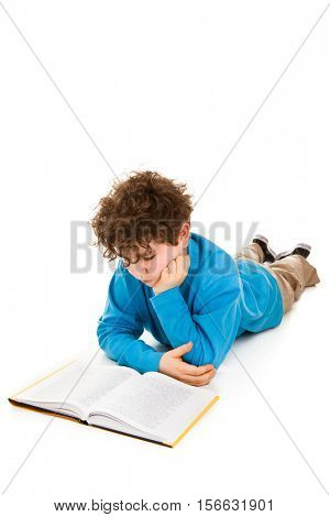 Boy lying and reading book