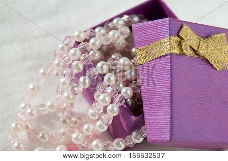 Ajar Purple Box With Pink Pearl Strings  Приоткрытая лиловая коробка с розовыми жемчужными нитями