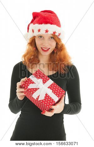 Young red haired woman with Christmas gift