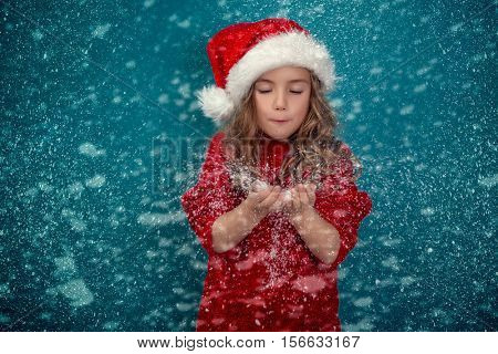christmas blowing litlittle cute girl
