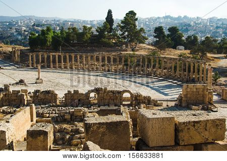 Photo of the Archaeological Site, park of Jerash. Oval Plaza and ruins sanctuary of Zeus Olympios. Tourism industry, sightseeing concept