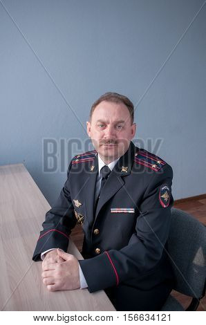 Portrait Of A Man With A Mustache In Police Uniform At A Table  Портрет мужчины с усами в полицейско