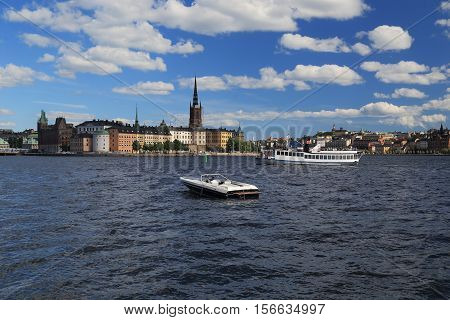 STOCKHOLM, SWEDEN - JUNE 27, 2016: This is view of the island Riddarholmen located on Lake Malaren which is part of Gamla Stan.