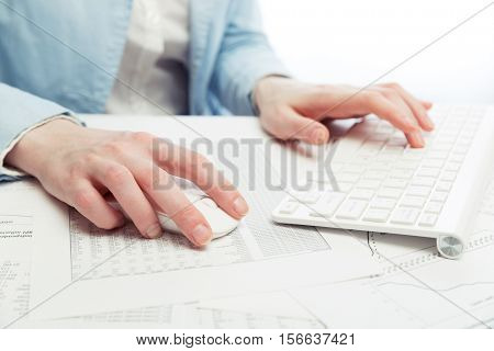 Business woman using computer mouse and keyboard