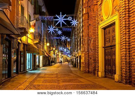 Old town of Alba with illuminations and decorations for Christmas holidays in Piedmont, Northern Italy.