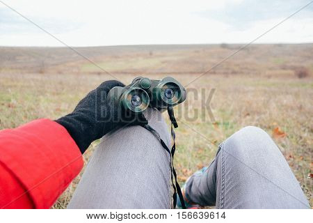 Young Woman Looking Through Binoculars On A Autumn Nature. Binoc