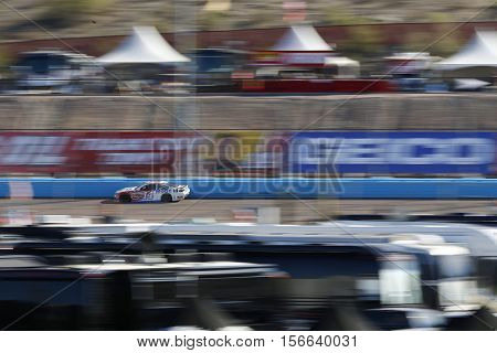 Avondale, AZ - Nov 13, 2016: Tony Stewart (14) battles for position during the Can-Am 500(k) at the Phoenix International Raceway in Avondale, AZ.