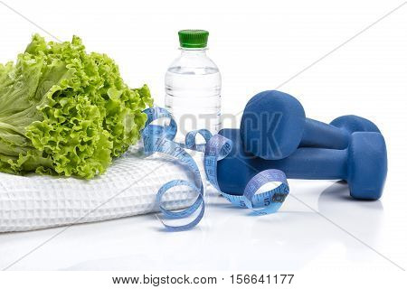 healthy eating, diet and weight loss, detox . dumbbells, lettuce and a bottle of water