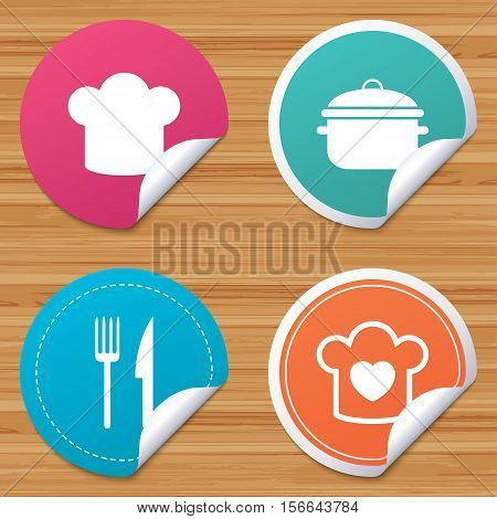 Round stickers or website banners. Chief hat and cooking pan icons. Fork and knife signs. Boil or stew food symbols. Circle badges with bended corner. Vector