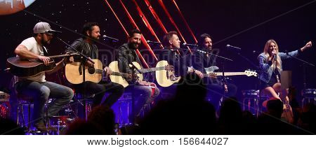 CHICAGO-NOV 9: (L-R) Tyler Farr, Old Dominion and Kelsea Ballerini perform at CBS Radio's Stars & Stripes event at the Chicago Theatre on November 9, 2016 in Chicago, Illinois.