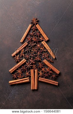 Anise and cinnamon spices christmas tree shape. Top view