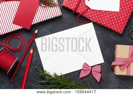 Christmas gift wrapping and blank greeting card. Top view with copy space