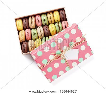 Colorful macaroons gift box. Sweet macarons present. Isolated on white background. Top view